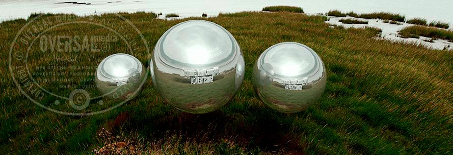 Three Metallic Orbs at the edge of a lake, Branding and Advertising